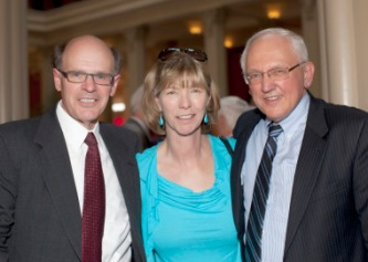 George and Lisa with Justice Anderson at retirement party.
