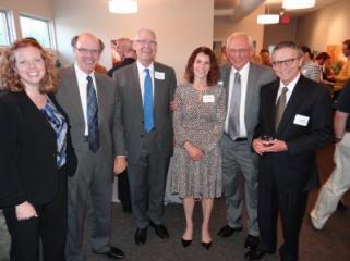 Partners Melissa and George, Justice David Lillehaug, Teddie Gaitas, Counsel Paul Anderson, Judge Mark Wernick.