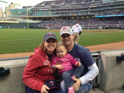 Melissa, Jason, and Emma cheering on the Minnesota Twins.