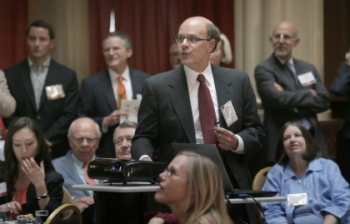 George made a presentation at retirement party for Minnesota Supreme Court Justice Paul Anderson in May 2013.